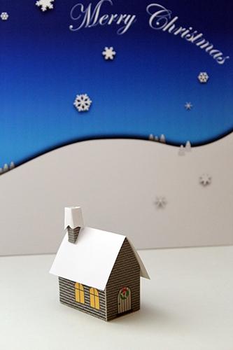 雪の背景付きクリスマスハウス