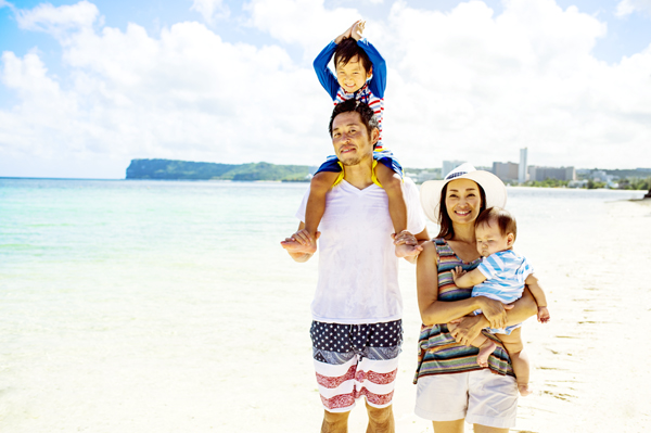 Family enjoying at the beach in guam